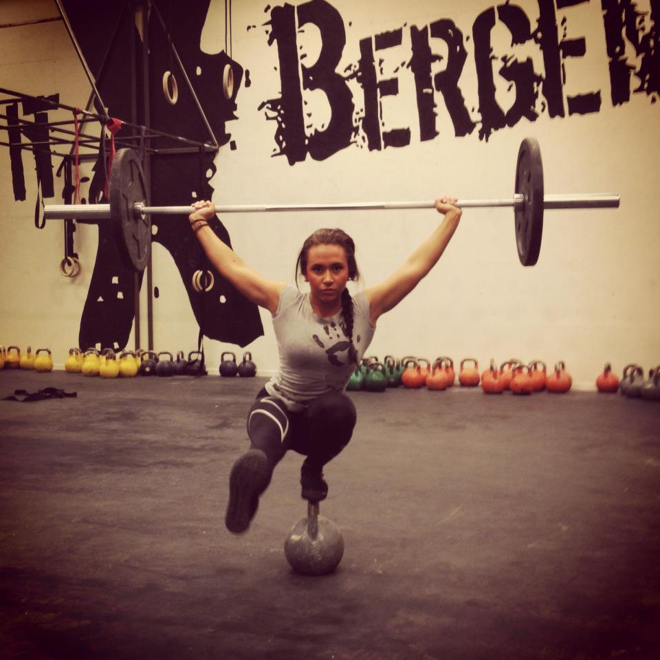 Figure 2; Susan Svanevik of Bergen Crossfit performing a barbell pistol squat atop a kettlebell